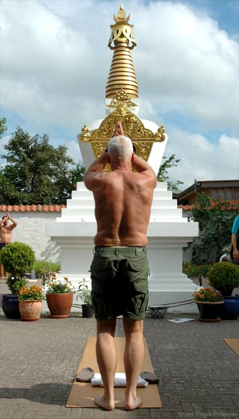Lama Ole Nydahl doing prostrations by the stupa in Rødby, Denmark